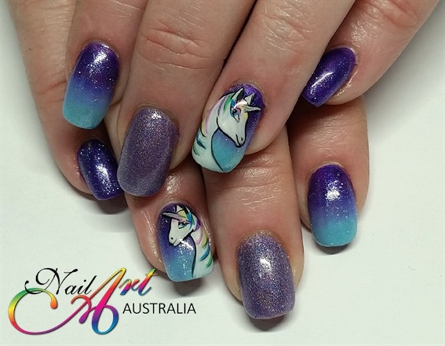 "<p><a href=""http://nailartgallery.nailsmag.com/loveprettynails/photo/565130/unicorn-nails"">Via Nail Art Gallery</a>.</p>"
