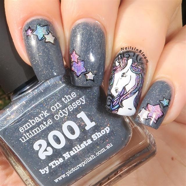 """<p><a href=""""http://nailartgallery.nailsmag.com/glittery_joy/photo/487030/holo-unicorn"""">Via Nail Art Gallery</a>.</p>"""