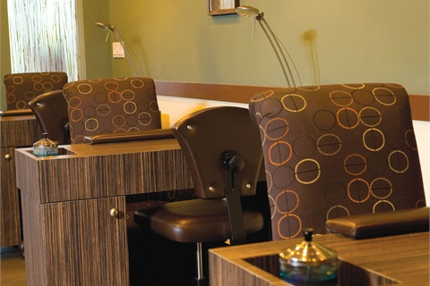 <p>Two separate service rooms allow clients some privacy — this room with three manicure stations also has four pedicure spa chairs.</p>