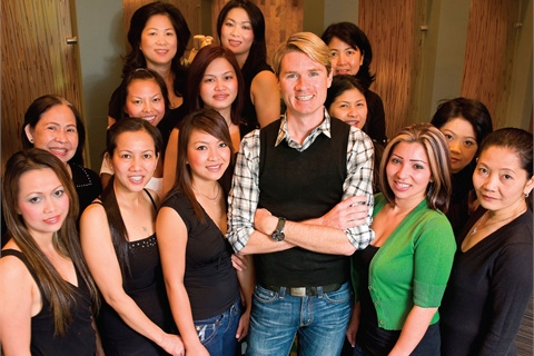 <p>Irwin, seen here with salon manager Maria Juarez (right of Irwin) and Orchard nail technicians, says mutual respect has led to employee retention.</p>