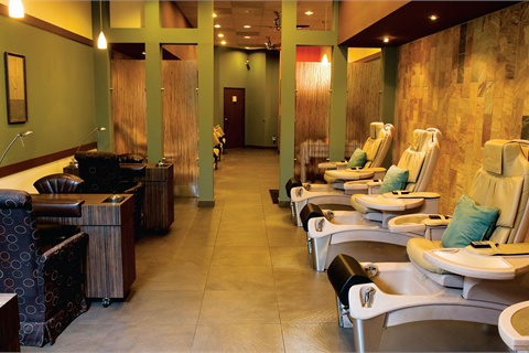 <p>Designed by co-owner Alex Hanshaw around pressed-glass bamboo partitions, the salon mostly consists of earth colors, with splashes of orange.</p>