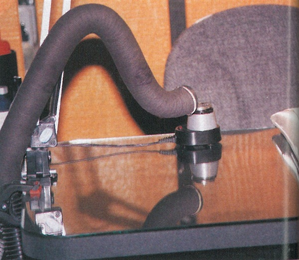 <p>Cash's home-made system uses flexible hose intended for a car to ventilate her table area.</p>