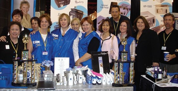 <p>Team Vicki members gather for a group photo at the Chicago Midwest Beauty Show in February<br />of this year.</p>
