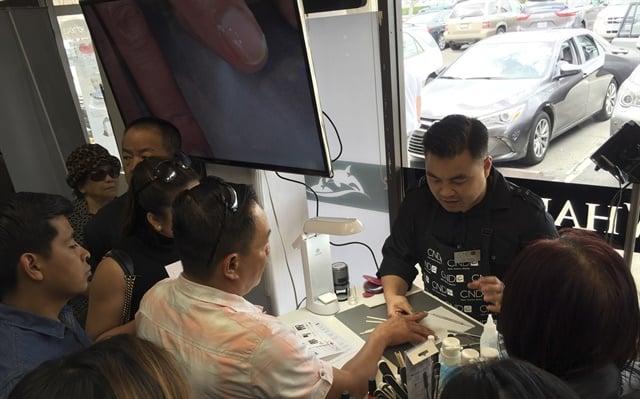 <p>CND education ambassador Kevin Nguyenshows how to use CND Vinylux.</p>