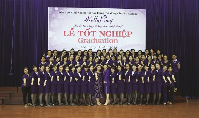Students smile in this graduating class photo from Kelly Pang Nail. Their next step may be to do nails within Vietnam or to relocate to another country and pursue a career in nails there.