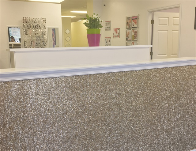 An idea of how the glittery wallpaper could look in your salon.