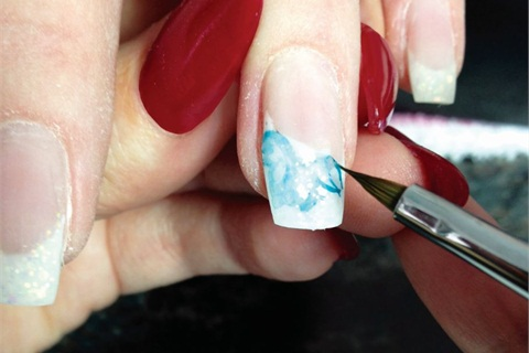 Beginner nail art with watercolor paint technique nails magazine clean the brush with water removing all paint with a damp brush smudge and soften the petal outline if you have too much watercolor paint on the nail prinsesfo Images