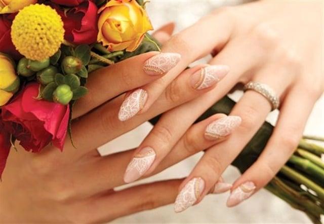 """<p>Via <a href=""""http://www.nailsmag.com/demoarticle/111144/acrylic-lace-bridal-nails"""">nailsmag.com</a></p>"""