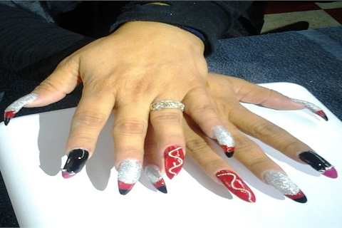 """<p>The winning nails were created with the team's red-and-black """"punk rock"""" theme in mind.</p>"""