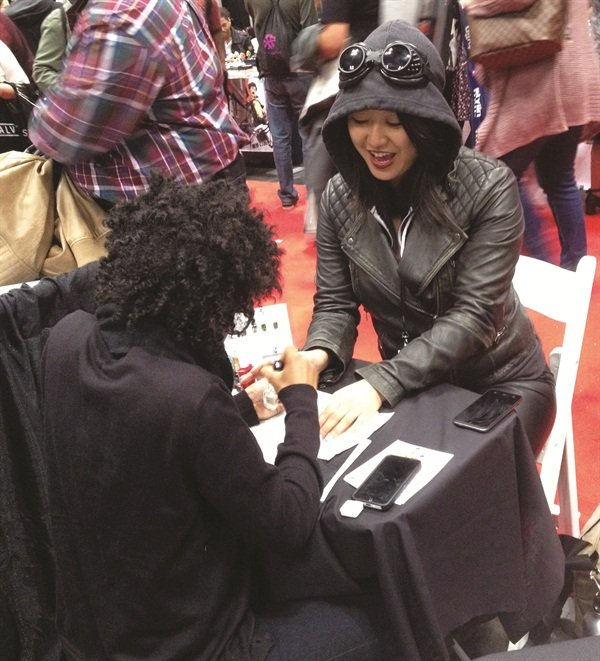 <p>Mimi (@nailsbymimi) works on a psyched client.</p>