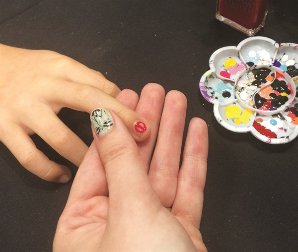 <p>Jane (@thatjanedesigns) uses Obsessive Compulsive Cosmetics polish to work on a Deadpool nail.</p>