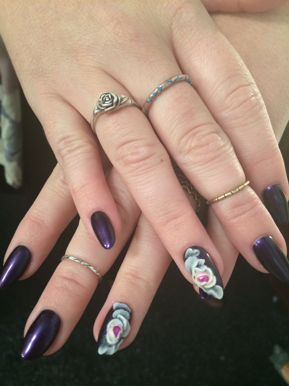 <p>Taylor Daniel's mixed-media nail art done with gel-polish, lacuqer, and ProHeasion.&nbsp;</p>