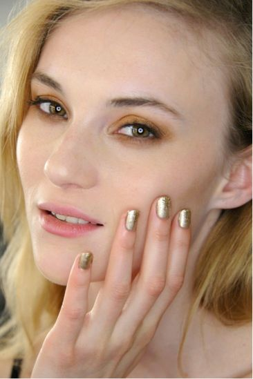 <p>Morgan Taylor stylist Danielle Candido crafted a matte metallic mani with a gold sparkle tip using Give Me Gold, Matte's A Wrap, and Glitter in Gold for the Karolyn Pho show. Images courtesy of Morgan Taylor Lacquer.</p>