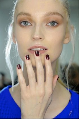 <p>Morgan Taylor lead stylist Gina Edwards polished nails at Kenneth Cole using From Paris With Love. Images courtesy of Morgan Taylor Lacquer.</p>