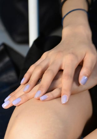 <p>For Suno, Maybelline Color Show Nail Lacquer in Porcelain Party and Blue Bombshell were mixed for a faint, feminine blue accent. Photo courtesy of Maybelline.&nbsp;</p>