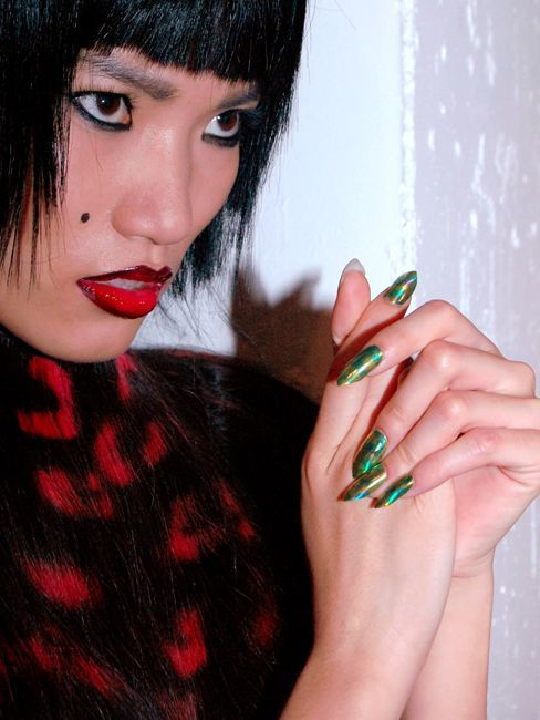 <p>At London Fashion Week, <strong>Minx</strong> collaborated with Nails at Work to create one-of-a-kind designs for the show. Models sported Yellow and Green python print and Minxlusion designs on super sharp V-point nails. (Photography by Jonn Dunn)</p>