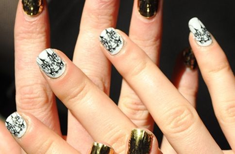 <p>NAIL ART: Celebrity nail tech Lisa Logan collaborated with designer Daniella Kallmeyer and with Minx co-founder Janice Jordan to create custom Minx nail coatings that featured the Daniella Kallmeyer logo in combinations of gold/black, red/black, white/black, and gold/matte black. Photography courtesy of Daniella Kallmeyer</p>
