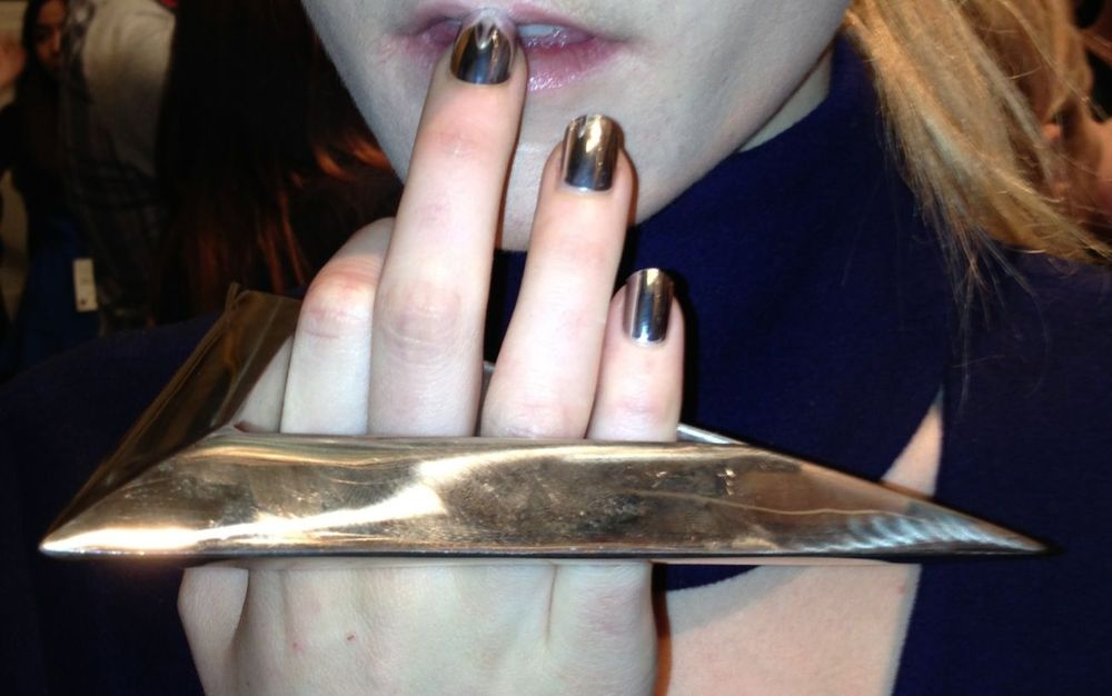 <p>METALLICS: During London Fashion Week, Fashion Scout Merit Award winner Yifang Wan selected Silver Lightning Minx nails to complement her Fall/Winter 2013 runway show. Photos courtesy of FTWS.&nbsp;</p>