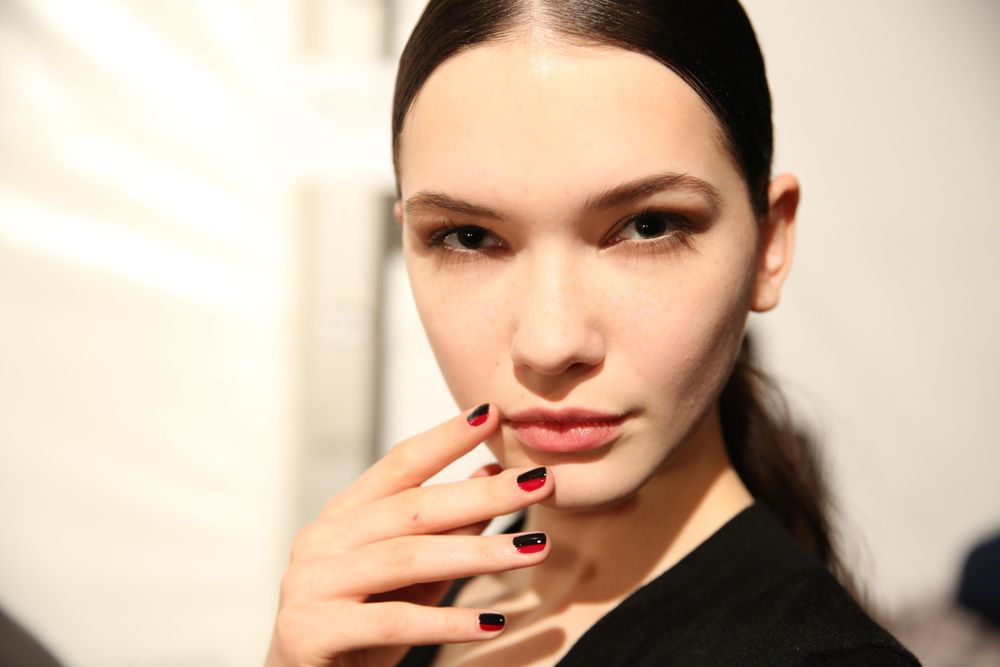 <p>Miss Pop created this color blocked look for Essie using Licorice and Bordeaux at the Mathieu Mirano show.</p>