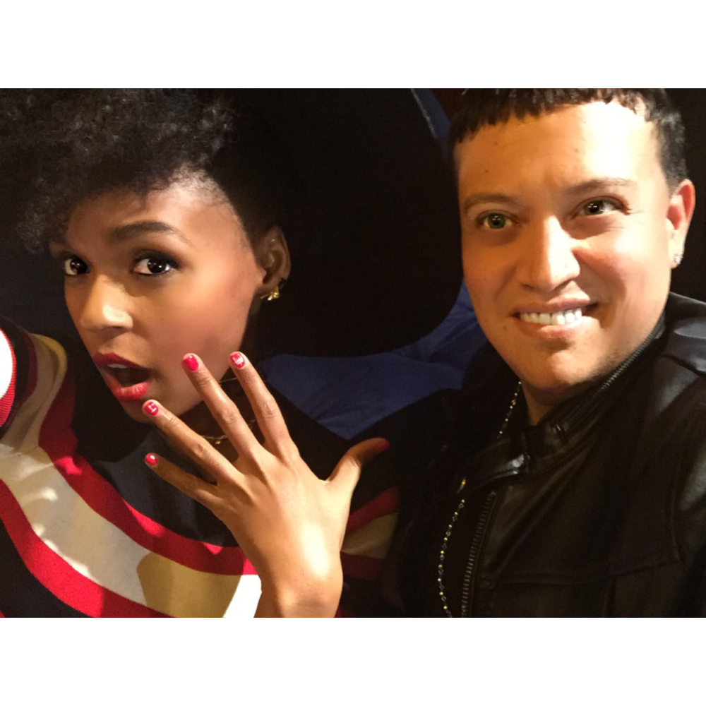 "<p>Mr. Luis used CND Shellac in Lobster Roll on Janelle Monae. Image via <a href=""https://instagram.com/mrluisnails/"">@mrluisnails</a></p>"