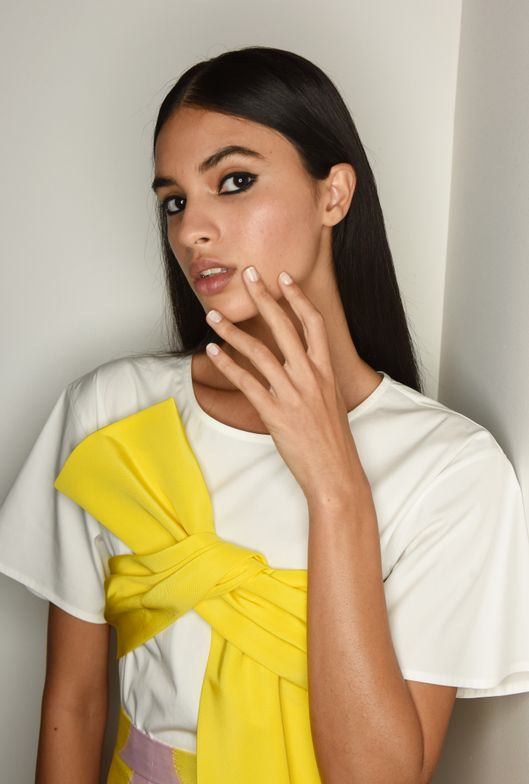 <p>Morgan Taylor Lacquer lead artist Gina Edwards created this look to complement the Carolina Herrera woman's bold confidence and optimistic energy. Courtesy of Morgan Taylor Lacquer.</p> <p></p>