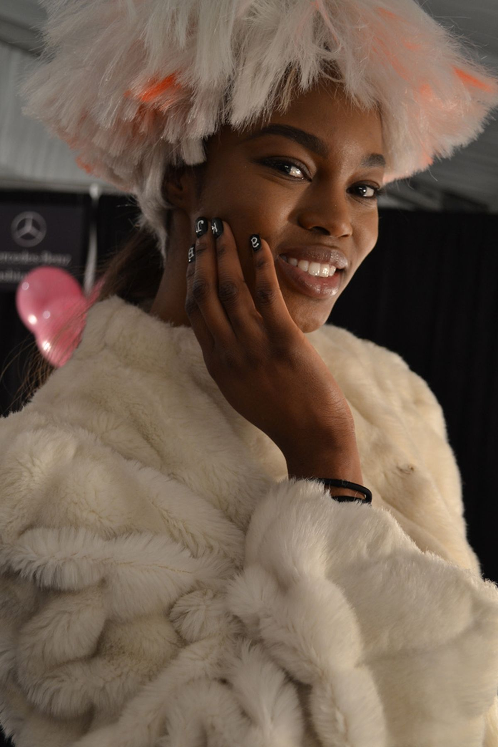 <p>NAIL ART: At the Betsey Johnson show, models wore Morgan Taylor polish, which is a brand new polish line from Hand &amp; Nail Harmony. This model is wearing Morgan Taylor in All White Now and Black Shadow.</p>