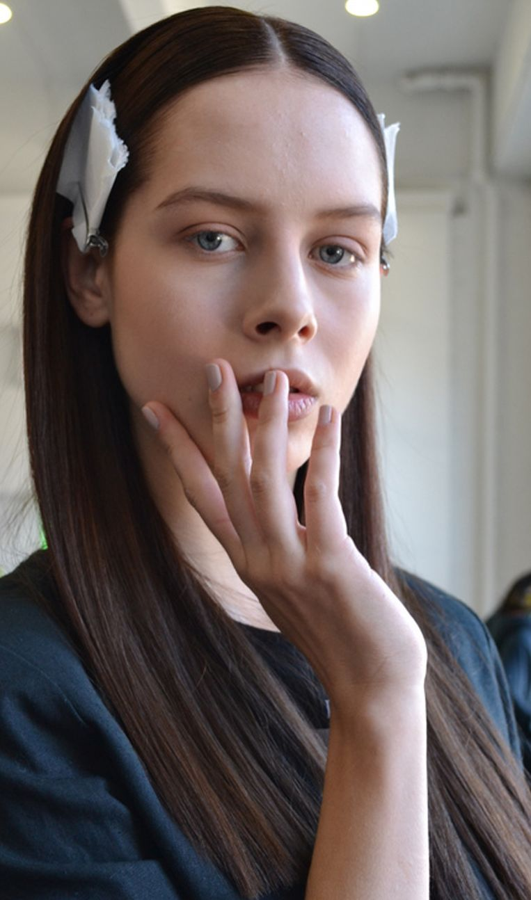 <p>NEUTRALS: At the Catherine Malandrino show, models wore Morgan Taylor polish, which is a brand new polish line from Hand &amp; Nail Harmony. This model wears custom blend of Morgan Taylor colors (2 parts It&rsquo;s in the Nude, one part Birthday Suit, and a drop of Polished Up).</p>