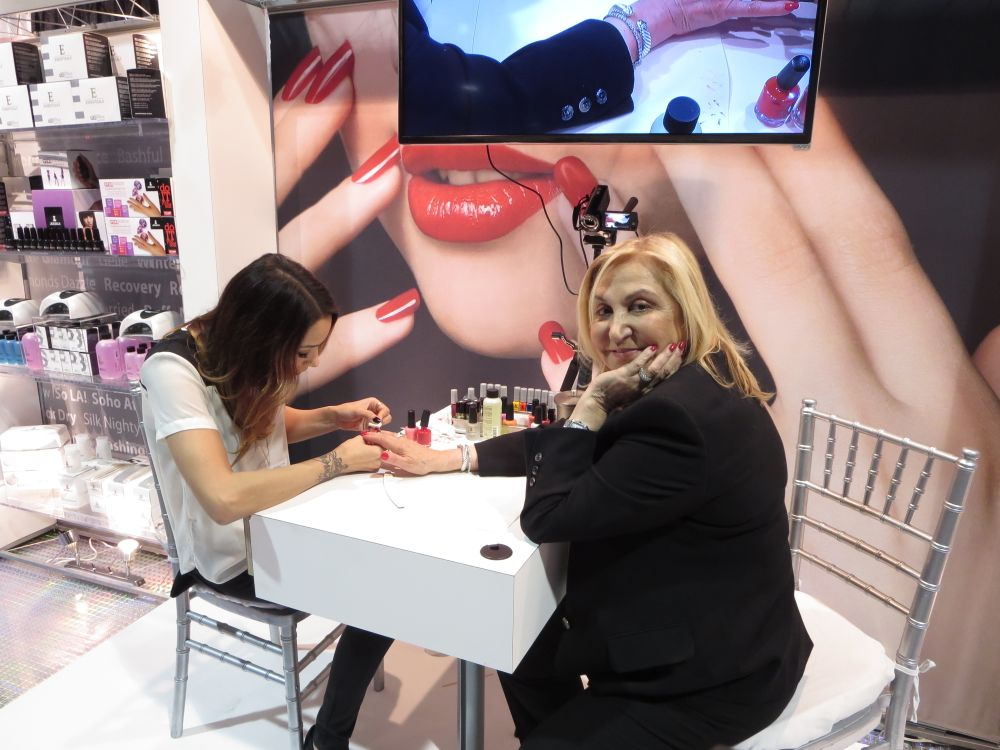 <p>The first lady of nails, Jessica herself, getting a manicure at her booth.&nbsp;</p>