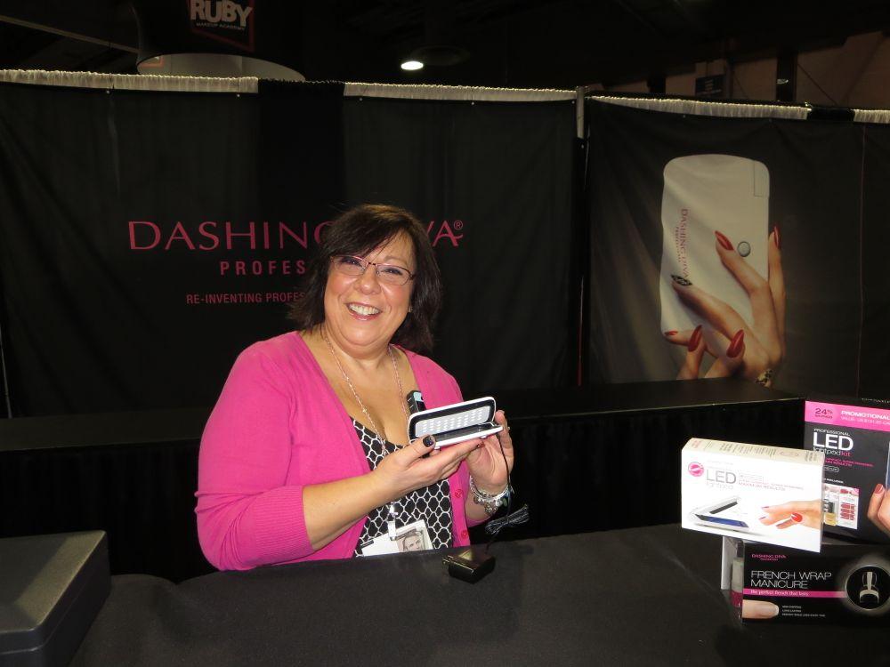 <p>Mary Jo Zwirowski shows off Dashing Diva's LED lightpod.&nbsp;</p>