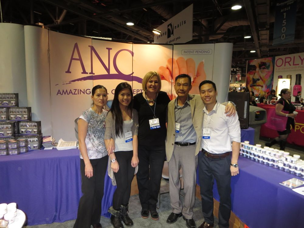 <p>The team at ANC poses at their booth.</p>