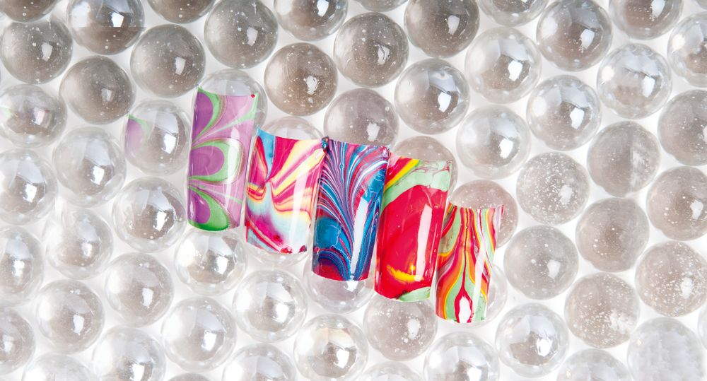 <p>Nails by Jamie Duffield, Nails by Jamie, Eugene, Ore. (All nails created using water marbleizing with polish)</p>