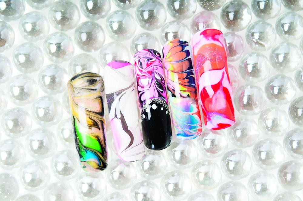<p>Nails by Dawn Doan, Just for Nails Salon, Stockbridge, Ga. (Nail 1 created using gel; Nail 2 with water marbleizing with polish; Nail 3-4 with polish; and Nail 5 with acrylic)</p>