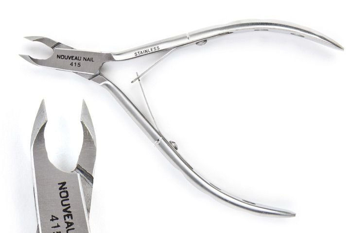 "<p>Made with 100% stainless steel, these <a href=""http://www.premiernailsource.com"">Nouveau Nail </a>Precision Double Spring Cuticle Nippers have a series of holes in the handles to help with gripping. Available in both the 1/4- and 1/2-jaw sizes, the nippers have a lifetime guarantee of no rust.</p>"