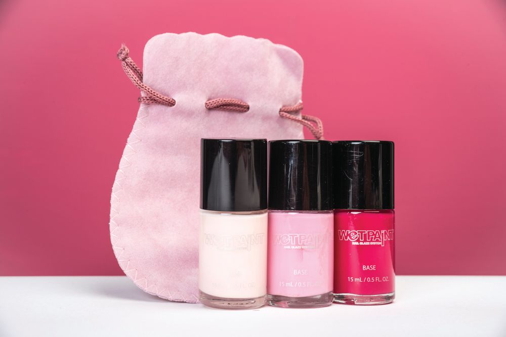 <p>Wet Paints reminds everyone to think pink during the month of October with its trio set of pink polishes packaged in a special light pink drawstring bag. The Reaching for the Pinks Collection includes Officially a Girl, a soft, baby doll pink; Call the Chauffer, a pure bubble gum pink; and Girl Boss, a sexy, hot pink. The set of three polishes will be sold at half price all month long. &nbsp;</p>