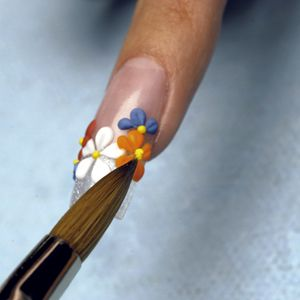Use a Aqua Falls and Mango to create petals for two additional flowers. Apply a small dry bead...