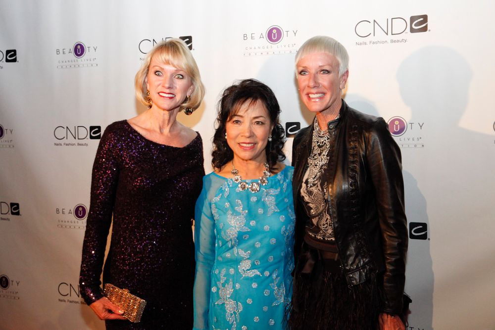 <p>Thuan Le (center), one of the original 20 Vietnamese women entering the nail industry, with Beauty Changes Lives president Lynelle Lynch (left) and CND co-founder Jan Arnold.</p>