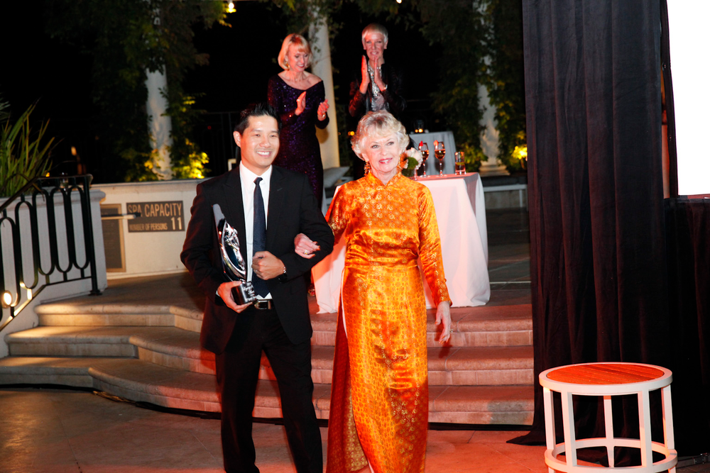 <p>Advance Beauty College's Tam Nguyen escorts Tippi Hedren with her Legacy of Style award.</p>
