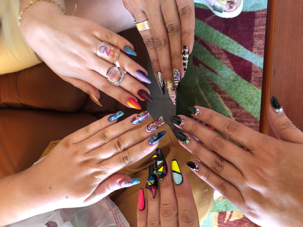 <p>Group nail photo with NTNA Top 3 finalists Ashton Harlan, Carly Snyr, Nixxi Rose, Season 5 winner Valerie Ducharme, and NAILS Beth Livesay.</p>