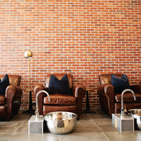 Salon owner Nina Babaie chose large leather chairs so male clients could be comfortable visiting...