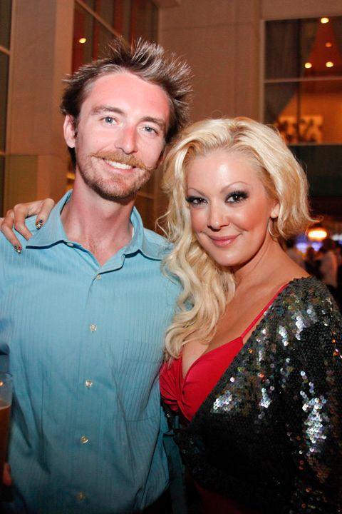 <p>NAILS' Tim Crowley with Katie Cazorla</p>