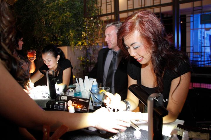 <p>Beautiful Nails by Kupa educators Ann Chang (far left) and Sindy Mark performed complimentary nail art designs on guests for Katie Cazorla's Nail Files season 2 premiere party</p>