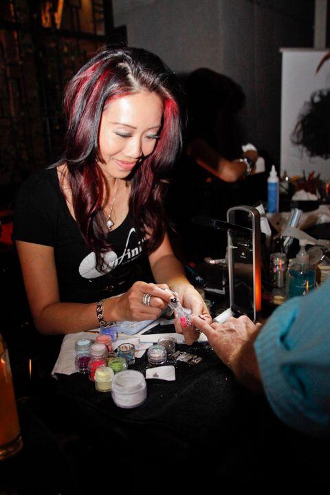 <p>Beautiful Nails educator Kiry Ya gives NAILS senior editor Tim Crowley an acrylic skull.</p>