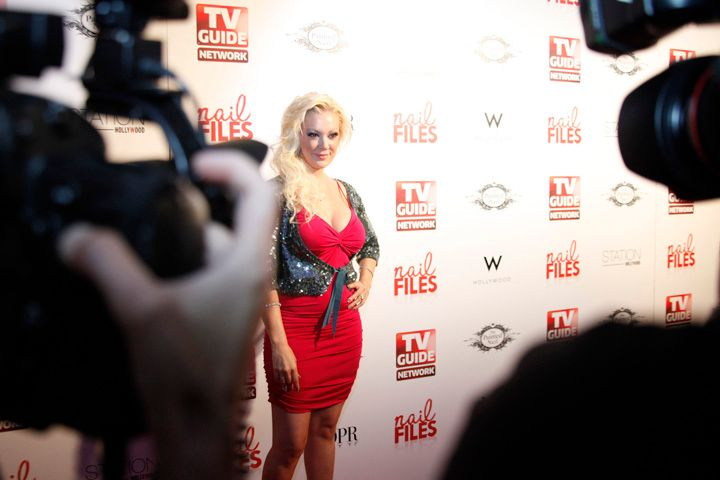 <p>Katie Cazorla makes her red carpet appearance</p>
