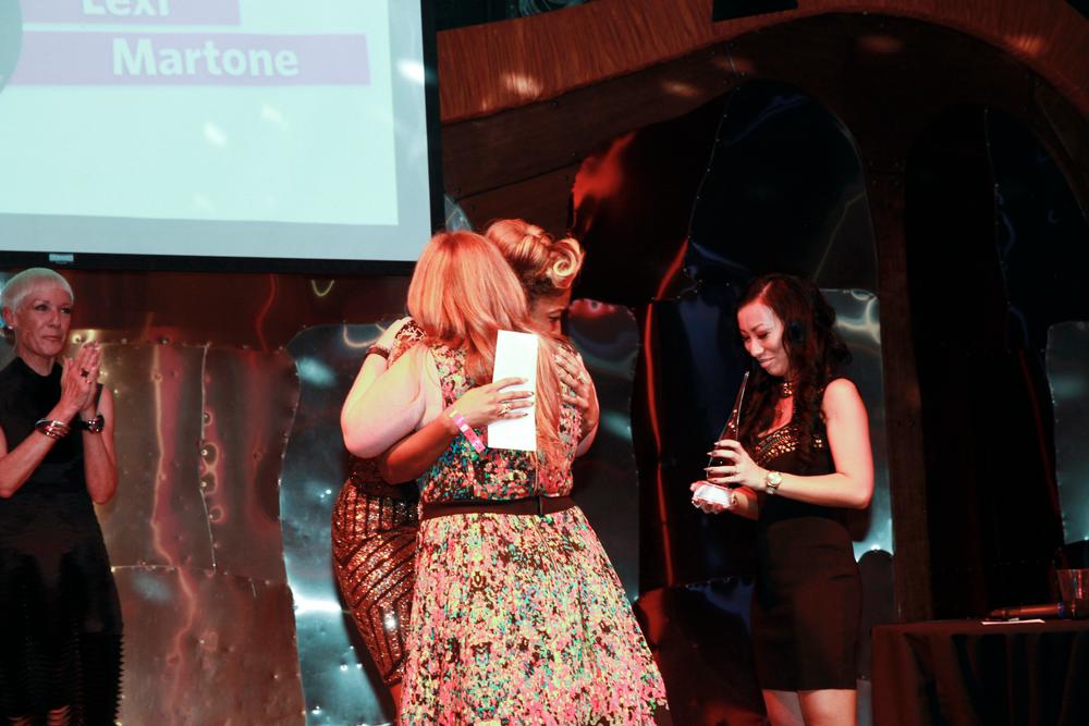 <p>NTNA 2014 winner Ryoko Garcia passes the trophy to NTNA 2015 winner Lavette Cephus.</p>