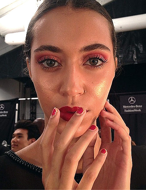 <p>The reddish-purple hue, Sphinx Purple, was crafted into nailbed-size circles and highlighted around the trendy shape with flecks of Nubar&rsquo;s Sexy Gold metallic polish for the Malan Breton show. Photo courtesy of Nubar.&nbsp;</p>
