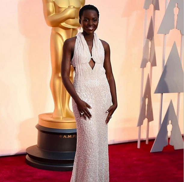 <p>Deborah Lippmann gave Lupita Nyong'o a pearlescent manicure to match her Oscar gown. On the underside of the star's nails are Swarovski crystal for even more glam. Image via @deborahlippmann</p>