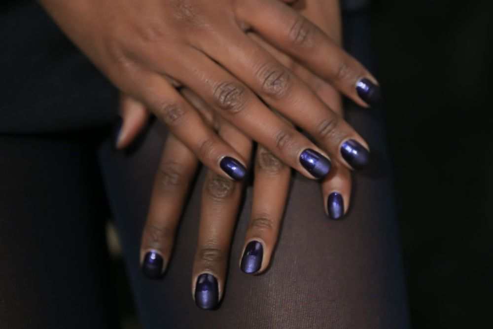 <p>OPI Matte Top Coat was applied to the top half of the nail in three vertical brush strokes. Stroke two more times horizontally from left to right to get a straight defining line at the center.</p>