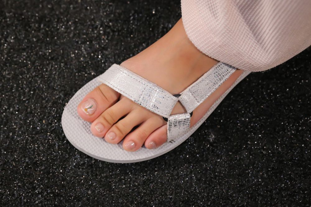 <p>Toes were lacquered in one coat of OPI Bubble Bath; each model's big toe was painted with a daisy falling toward the nail's free edge for Charlotte Ronson. Photo courtesy of OPI.</p>
