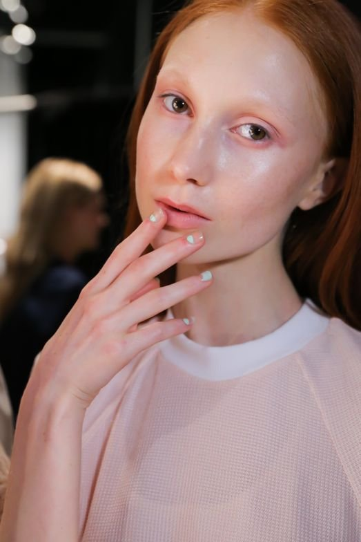 <p>At Charlotte Ronson each model sported one hand with the pinky, middle and pointer fingers featuring a painted nail with a natural half moon, and the ring and thumb fingers featuring a natural nail with a painted half moon. Photo courtesy of OPI.&nbsp;</p>