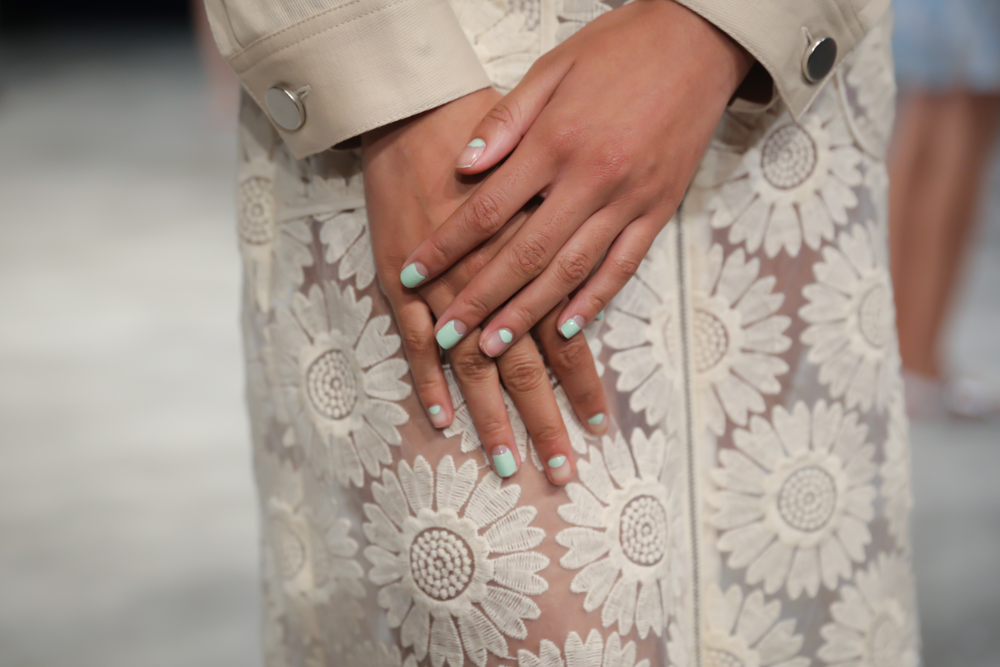 <p>On the other hand at Charlotte Ronson, the look was reversed, with the pinky, middle and pointer fingers featuring the natural nail with a painted half moon, while the ring and thumb fingers had the painted nail with a natural half moon.Photo courtesy of OPI.&nbsp;</p>